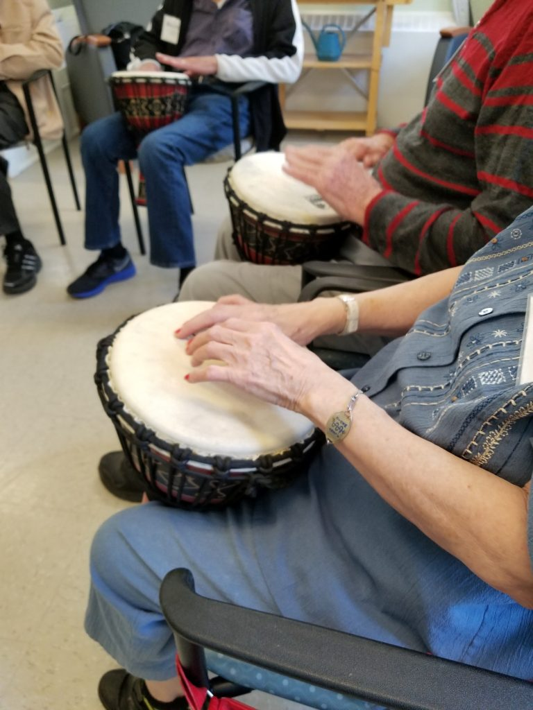 pictures of seniors playing African drums