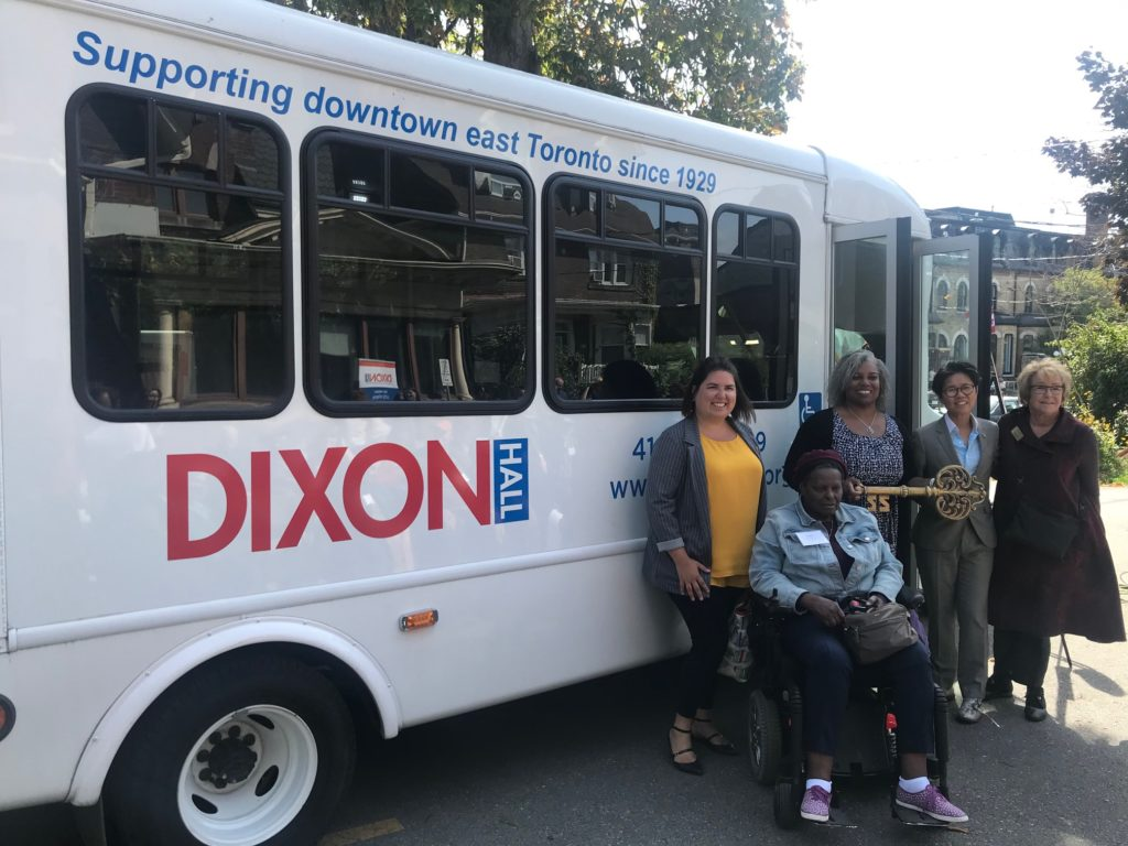 "Dixon Hall, city of Toronto, and province of Ontario representatives are presented with the ""key"" to the new, accessible bus"