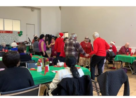 group of seniors dance at a christmas party