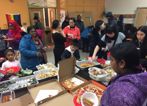 music school students and their families enjoy food during a celebration
