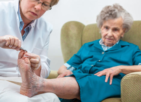 elderly woman with chiropody and body care at home